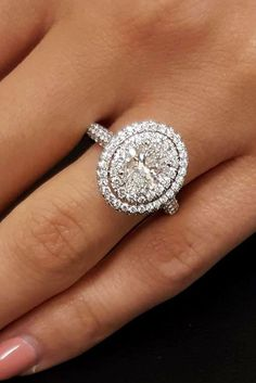 21 Unique Engagement Rings That Will Make Her Happy ❤ unique engagement rings round halo white gold pave band ❤ More on the blog: https://ohsoperfectproposal.com/unique-engagement-rings/ #UniqueEngagementRings #halorings