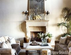 "In this Montecito living room designed by Christina Rottman, the lustrous neutrals create harmony and tranquillity. Rottman layered classical elements and sensual textures ""to bring the room to life and give it a feeling of both informality and formality."" Sofas are upholstered in linen velvet, Largo in Fawn, and the ottoman in leather, Lucia in London Fog, both by Rose Tarlow. The silk velvet throws are by Sabina Fay Braxton; print pillows are in Fortuny's Delfino String and Silvery Gold."