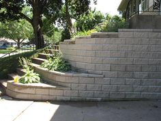 driveway retaining wall with carved iron fence