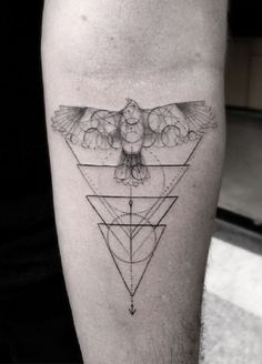 Beautiful and well drawn Triangle Glyph Tattoo. There are a series of triangles in upside down positions on this design. It also looks like a blueprint of some sort with a drawing of a flying bird on top. The sketch based look of the design makes it even more intriguing.