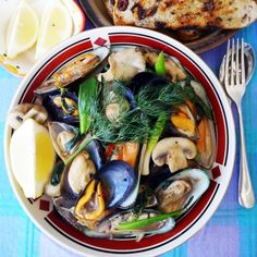 Well Sea Food & Mushrooms :) Kua hoi mussel sai het - a delicious Lao-Australian stir-fry of mussels with mushrooms in a mildly spicy oyster and basil sauce.