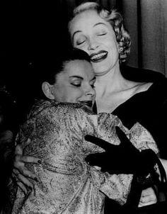 Marlene Dietrich visiting Judy Garland back stage in a genuine embrace.