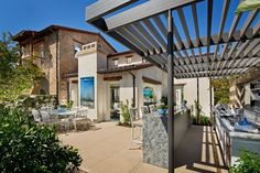 Mediterranean Patio with Outdoor kitchen, Trellis, Fence, Wrap around porch, exterior stone floors