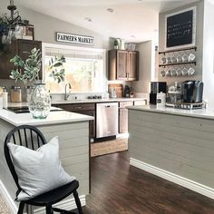 # @thedecorator_on43rd Good morning sunshine! Who's happy Friday has arrived? It sure has arrived in glorious splendor in this kitchen! We love your coffee bar nook, ready and waiting for action for all who pass into the kitchen. We love your shiplap style too! Thanks for sharing your sunny bright view with us, and for showcasing our Farmer's Market Sign above your sink. Now, time for some coffee!⠀ ⠀ #myafh #antiquefarmhouse #farmhouse #farmhousechic #farmhousekitchen #modernfarmhouse