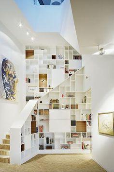 Modern Staircase with Hardwood floors, Built-in bookshelf, High ceiling, flush light