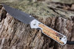 "Chris Reeve Large Sebenza 21 Folding Knife 3.625"" Ladder Damascus Blade, Titanium with Elder Burl Inlays - KnifeCenter - CRKSEB21LLDEBW"