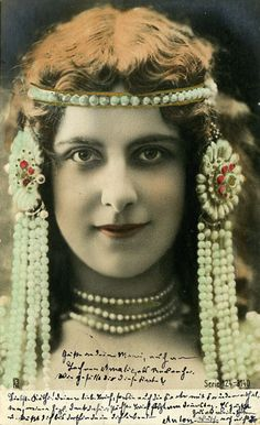 """Stunning tinted portrait of a women in elaborate """"oriental""""/exotic style pearl headdress, 1903."""