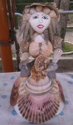 Doll of shells