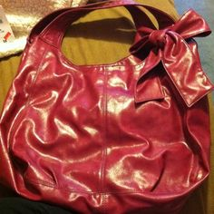 **REDUCED** Large purple purse from fashion bug. Large purple purse with a bow on the top right corner. Everything zips and buttons correctly. Bags