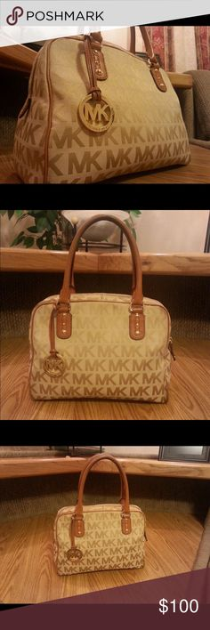 Too big for my taste Authentic Michael Kors large beige Satchel and, genuine leather handbag! The frame is lined with Genuine leather and also has genuine leather handles. One handle holding a leather strap that adorns purse with MK golden pendant. Four gold studs on bottom of purse.  Gold studs also below handles. Each interior pocket and zipper compartment is lined with genuine leather. Interior material is marked with Michael Kors brand name. Few ink pen marks on inside. Some rubber on…