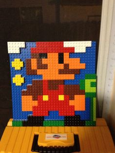 Mario made out of Legos Lego Wall Art, Diy Wall Art, Lego Coding, Pictures Of Bricks, Lego Mario, Lego Mosaic, Lego Challenge, Lego Activities, Game Room Decor