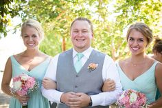 Bride's two sisters and Groom's brother walking hand and hand down the alter as co-maids of honor and best man! #summerwedding #outdoorwedding #mintandpeach #greysuit #bridesmaids #bestman