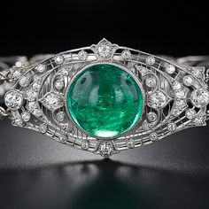 Oh my.  Look at the detail in this emerald and diamond bracelet!  This Edwardian Bracelet is from the beginning of the 20th century.  It is made from a luscious green 10 carat cabochon emerald.33,000.00 worth of yumminess.