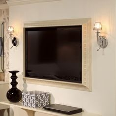 SO neat!! frame a flat-screen TV using crown molding... yes for a bedroom!