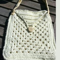 """Knit Crotchet purse boho festival bag ivory bag Super cute white boho crochet bag. Great for everyday use, as a travel, messenger or festival bag to name the least. Free people style, used in link for comparison. Actual vintage 70s bag.  Length: 13.5"""" inches Across: 12"""" inches Color: Ivory Description: Crochet bag with one front button with cool diamond patterned design Free People Bags Shoulder Bags"""