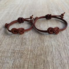 Brown Leather matching bracelets  These lovely bracelets are made with genuine leather cord. Designed for couples  Both bracelets are adjustable  Includes: Gift Box + 2 Bracelets  Note: Not Waterproof  Please feel free to contact me if you have any questions  These bracelet will be shipped by USPS First Class as soon as the payment is been received   For more Couples Bracelets: https://www.etsy.com/shop/Fanfarria?section_id=17115613&ref=shopsection_leftnav_10  Check all Fanfarrias products…