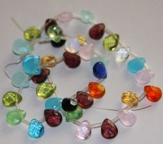 40 pcs of multi color faceted flat briolette glass beads 8 x10mm on Etsy, $8.50