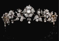 A diamond and pearl belle epqoue tiara, circa 1880, property of an Italian Princely Family. Designed as a series of flower heads, with alternate diamond and pearl centers, and linked by foliate sprays. This piece fetched CHF 97,000 at Sotheby's auction on 14th May 2013.