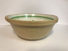 A true oldie and very hard to find with the green dot and band. Well used and well loved, this Easimix bowl by T. G. Green dates back to the 30s and 40s. The cream colored interior is decorated with a green stripe and a dot that tells you where the flat edge of the bowl is for tipping. Back in the day, these stoneware bowls would have been a staple in any kitchen long before Fire King and Pyrex came along with their milk glass bowls. This old bowl is in good sound condition - no chips or…