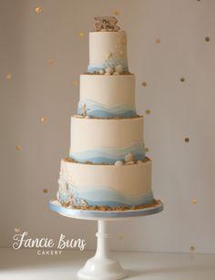 Modern Beach Themed cake, with shells, netting, fondant wave effect & driftwood Mr & Mrs plaque topper.