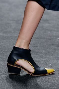 2018 black just below the ankle shoes with a touch of yellow. classy low heel. side cut out. polished.