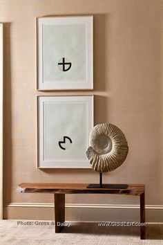 Custom designed wood bench from Tucker Robbins, two works on paper by artist Jo Baer from 1972, and a white Ammonite Nautilus Fossil on a stand from the beginning of time www.GISSLER.com