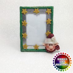 I hope you enjoy browsing through all of my Holiday FuzzyKims and other Holiday Kreations . These Kreations here in my gallery have all been adopted. To see all my available Kreations. Christmas Picture Frames, Christmas Pictures, Diy Clay, Clay Crafts, Cake Frame, Christmas Elf, Holiday, Polymer Clay Christmas, Cake Toppers