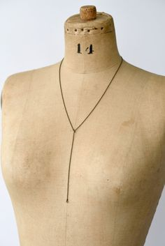The Laia Brass Ball Chain Lariat is a sweet and simple necklace made with fine brass ball chain and featuring two tiny rings at each end. This Lariat style necklace is subtle yet elegant making it perfect for any outfit from jeans and Tshirt to an an unexpected accent to formalwear. Its long Y necklace style creates a sensual silhouette but the organic tone of the brass makes it an easy piece for everyday wear. Each piece is sent out gift wrapped in tissue and a hand-stamped muslin bag and…