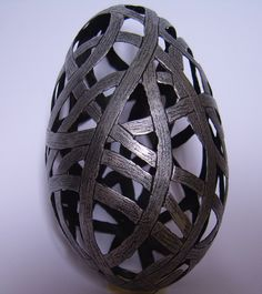 Carved goose eggshell with aged metal patina..........Middle Ages look
