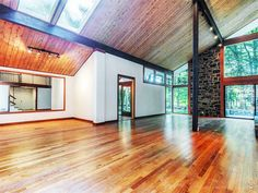 Empty wood cabin with lots of space and two skylights // Angelina Jolie's childhood home