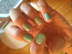 Mint, tan, and gold glitter nails with stripes!
