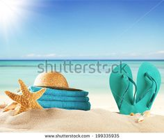 Summer concept with swimming accessories and blur sea on background by Jag_cz, via Shutterstock