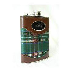 "Personalized Stainless Steel Tartan and Leather Flask  Whether you fill it with a wee bit of Jameson's or any other favorite libation, this personalized plaid flask is the perfect present for any occasion. Adorned with rich brown leather, our stainless steel flask has an easy-to-open cap and is small enough to fit in a jacket pocket. Holds 8 ounces. Measures 6"" x 4"" x 3/4"". Personalized with two lines of up to 15 characters per line. Imported.  #CreativeIrishGifts #Irish #Ireland"