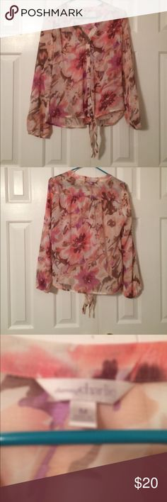 Floral blouse Floral button blouse. Ties at bottom. Worn once. Charming Charlie Tops Blouses