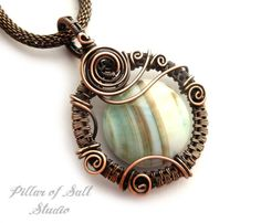 Handmade wire wrapped pendant, a one of a kind jewelry piece.    This agate stone has stripes of creamy turquoise, brown, and white. It was