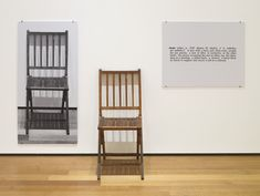 "Joseph Kosuth  One and Three Chairs  1965. Wood folding chair, mounted photograph of a chair, and mounted photographic enlargement of the dictionary definition of ""chair"","