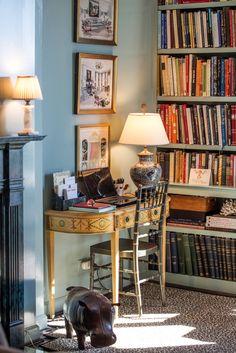 Atlanta apartment of Jennifer Boles, who writes the blog, The Peak of Chic. Farrow & Ball Powder Blue walls + leopard carpet.