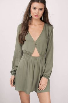 "Shop the ""My Darling Olive Skater Dress"" on Tobi.com now! This lightweight fit and flare dress with long sleeves features a midriff cutout and v-neck. This is the perfect daytime casual outfit on sunny days. Pair with ankle booties and your fav sunglasses"