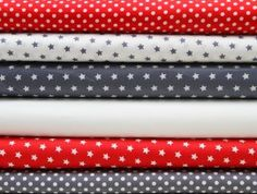 Stenzo fabric in grey and red with stars and dots