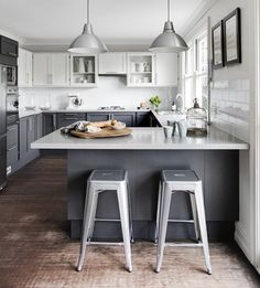 White and grey kitchen. The white upper cabins look like not existing this way.
