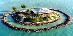 For $12,000,000 you get a house on a private island off Florida with a moat, a boat, and a helicopter pad!