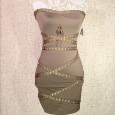 FOREVER 21 dress Neutral bodycon dress. Gold Studded brand new. Zip up in the back. Fit to curves. Bundle this with the dusty neutral Michael Kors trend and make a fashion statement in the city ! Forever 21 Dresses Strapless