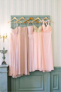 Mistmatched pink bridesmaid dresses.