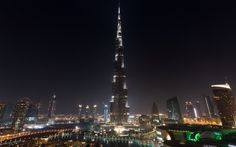 An iconic structure of UAE which made the world to turn its eyes on Dubai is Burj Khalifa. Currently, it prides to be the tallest building on the planet. Beautiful Places In The World, Beautiful Places To Visit, Cool Places To Visit, Dubai Skyscraper, Dubai City, Dubai Uae, Holidays Around The World, Around The Worlds, Arab Wallpaper
