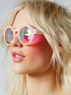Kaleidoscope Sunglasses   Go all the way groovy in kaleidoscope style with these festival-ready sunglasses. Featuring glass crystal lenses with prismatic details for a vivid visibility effect that expands awareness and stretches the mind's eye. Round plastic frames make for a retro-inspired look.