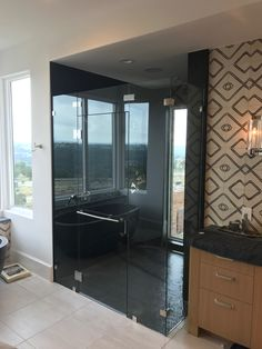 Custom Glass Shower Enclosure - Frameless 90 Degree Glass Shower Enclosure with Fixed Transom Over the Door. Contact Arrow Glass and Mirror, located in Austin, TX today to learn more 512-339-4888 or email sales@glassgang.com.