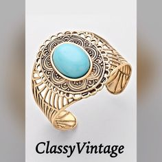NEW LISTING Gold tone & turquoise cuff! Gold tone cut out cuff bracelet with a faux turquoise stone. Boutique Jewelry Bracelets