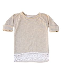A touch of delicate lace brings sweet charm to this tunic crafted from supersoft fabric that wraps your little princess in all-day comfort.