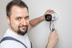 Professional cctv technician working Pre... | Premium Photo #Freepik #photo #people #technology #house #camera Green Grass Background, Computer Hacker, Distribution Board, Video Surveillance Cameras, Video Security, Panel Systems, Security Cameras For Home, Technology, People
