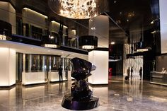 Futuristic Hotel Lobby for Luxury Interior Design with Ceiling Chandelier and Cool Lighting Idea